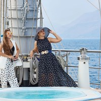 guests dressed next to jacuzzi on the ship top deck