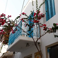 island town white balcony with red flowers